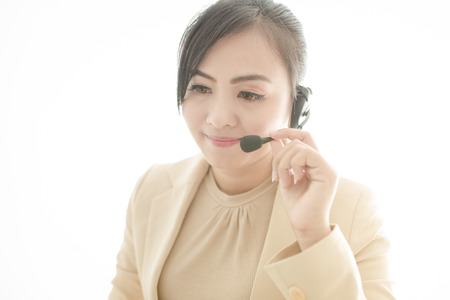 handsfree phone: businesswoman talking on the phone while working