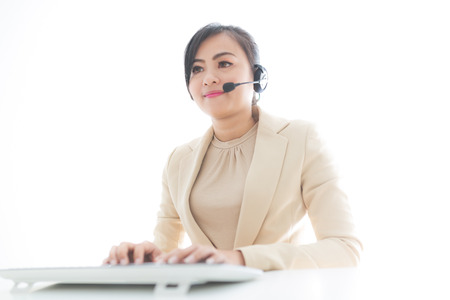 handsfree phones: Businesswoman talking on the phone while working