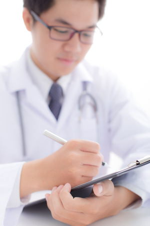 prescribing: Close-up Of Male Doctor Filling The Medical Form
