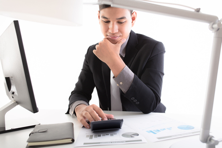 Businessman analyzing investment charts with laptop. Accounting 写真素材