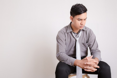 depression: Isolated young business man depressive