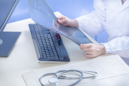 female form: Close-up Of Female Doctor Filling The Medical Form Stock Photo