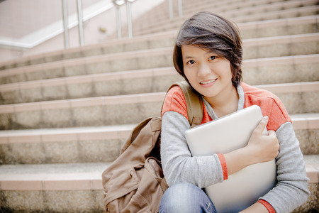 woman stairs: Young woman using laptop on steps outdoors Stock Photo