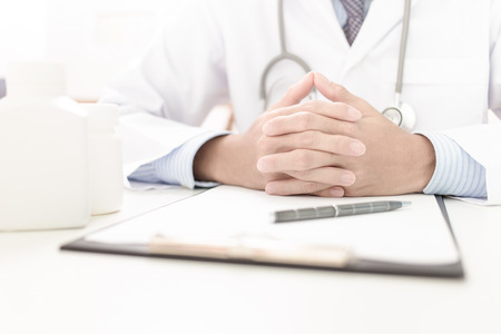 doctor writing: Portrait of a doctor writing a prescription Stock Photo