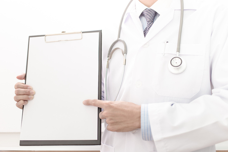 person writing: Portrait of a doctor writing a prescription Stock Photo