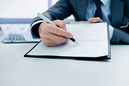Business man signing a contract Stock Photo - 46206898