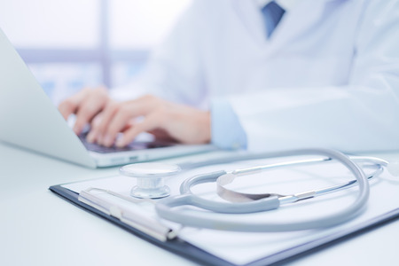 peripherals: Close-up of a medical worker with laptop Stock Photo