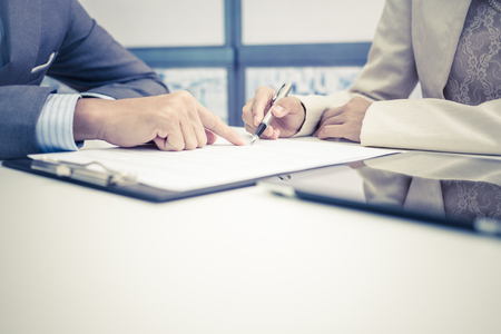 contract signing: Female hand signing contract. Stock Photo