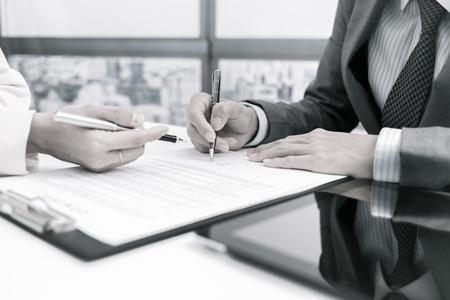 Business man signing a contract Archivio Fotografico
