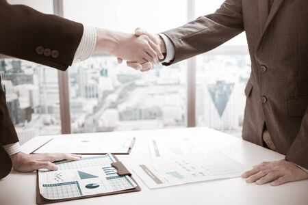 hand in hand: businessmen shaking hands