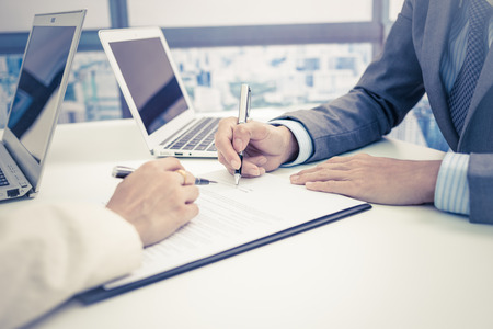 Business man signing a contract Stock Photo - 46625778
