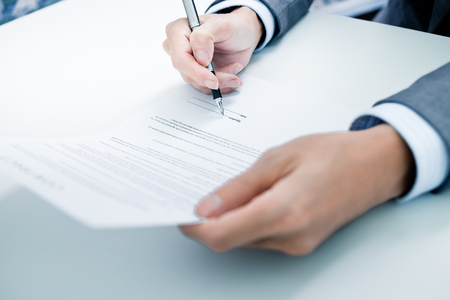 sign contract: Business man signing a contract Stock Photo