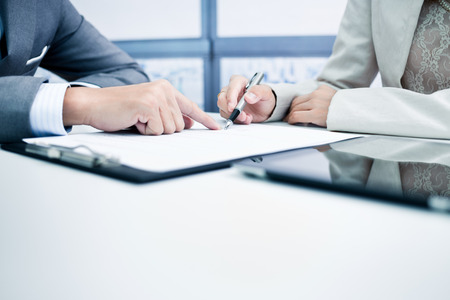 hand sign: Female hand signing contract. Stock Photo