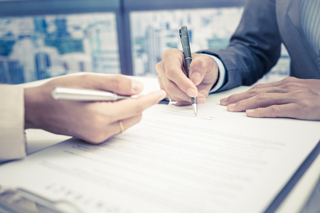 hand job: Business man signing a contract Stock Photo