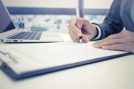 Business man signing a contract Stock Photo - 47154676