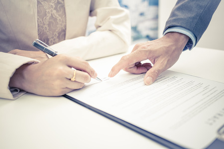 divorce court: Female hand signing contract. Stock Photo