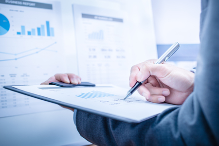 Businessman analyzing investment charts. Accounting Stock Photo - 47346437