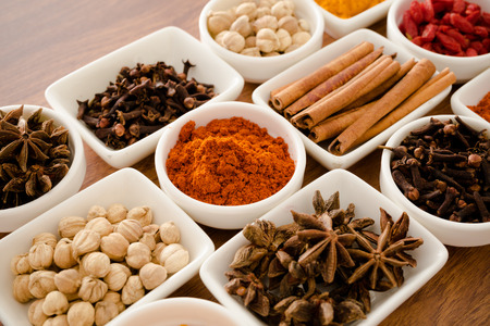 oriental poppy: Wooden table of colorful spices Stock Photo