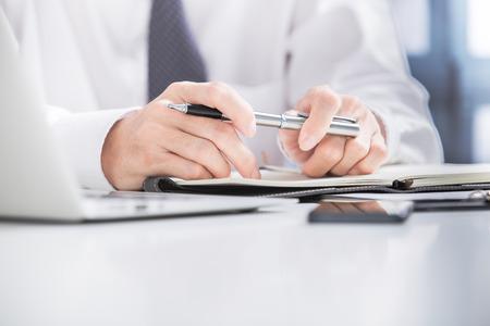 human resource management: Businessman analyzing data in office