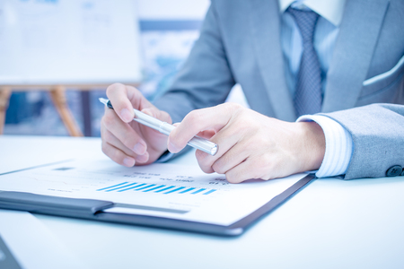 Accountant: Businessman analyzing investment charts. Accounting