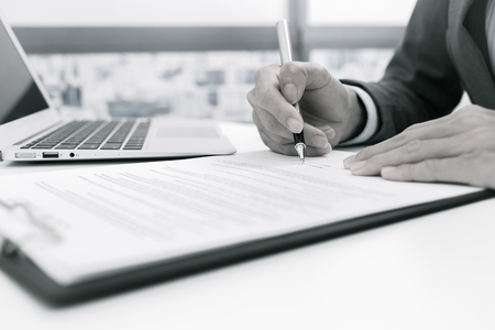business contract: Business man signing a contract Stock Photo
