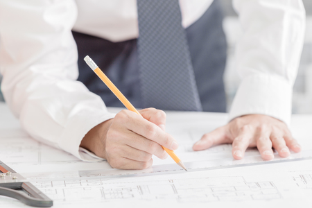 autocad: Architect working on blueprint Stock Photo