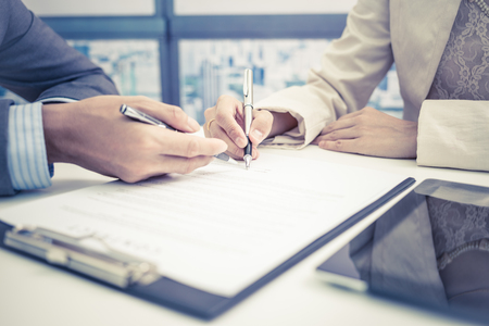 sign contract: Female hand signing contract. Stock Photo