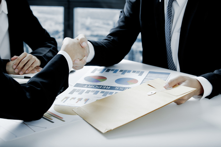 group business: Business handshake and business people Stock Photo
