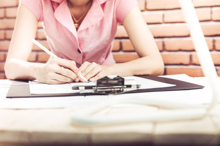 female architect: Female architect working at home.She looking at blueprint.