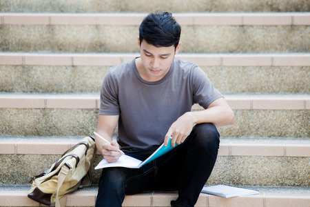 staircase: Smiling college student sitting on staircase