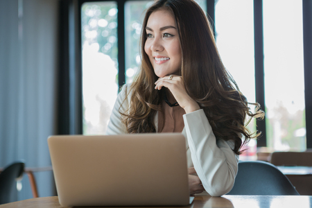 break from work: Businesswoman drinking coffee  tea and using tablet computer in a coffee shop
