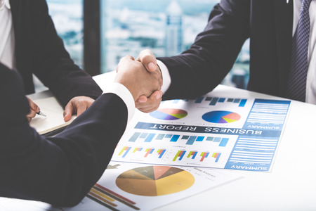 Business handshake and business people Standard-Bild