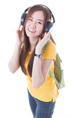 female student: happy teen girl listening to music, full length, isolated on white