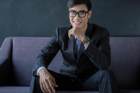 sofa: Businessman sitting on sofa Stock Photo