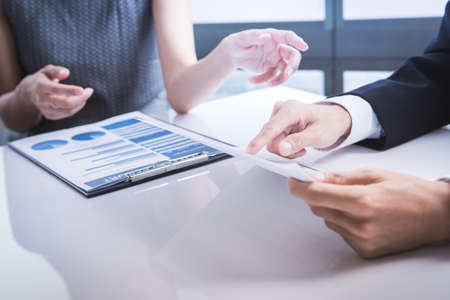 denoting: Business adviser analyzing financial figures denoting the progress in the work of the company