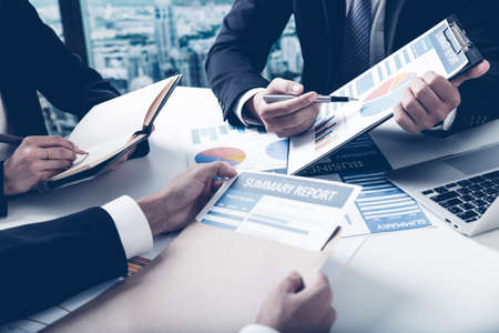 business matter: Group of business people busy discussing financial matter during meeting