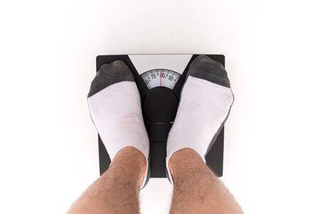 weigh machine: Closeup of a Asians weighed