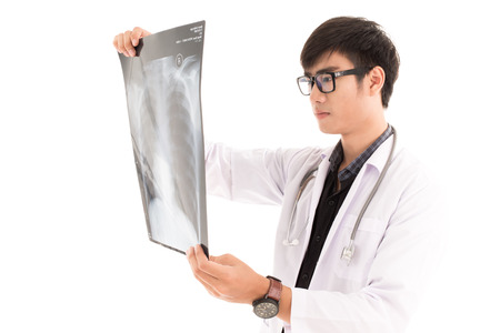 Young asia doctor check x-ray isolated on white. Asian male model