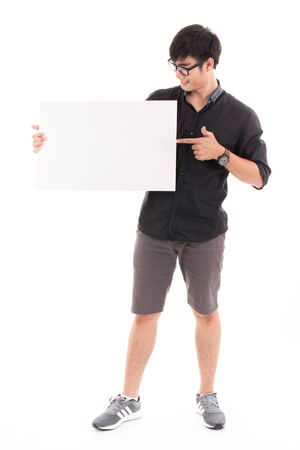 white poster: Male student holding a white board against white background. Asian male model