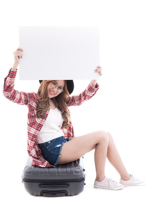 hitch hiker: Asian woman holding a white board with a suitcase on white background. Stock Photo