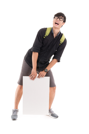 Male student holding a white board against white background. Asian male model