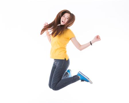 Collegio femminile di salto / studente universitario isolato su priorità bassa bianca. Studenti caucasici asiatici della giovane donna. Archivio Fotografico - 65861023