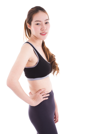 female sexuality: beautiful young sporty muscular woman, isolated against white background.asia Stock Photo