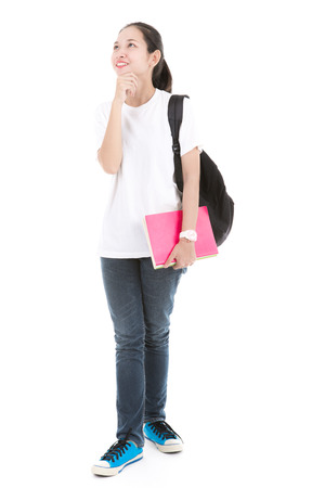 Young asian student girl with book. Isolated on white background.