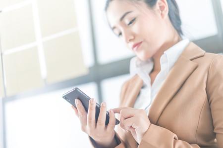 businesswoman using smart phone Stock Photo