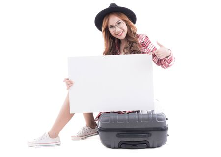 Asian woman holding a white board with a suitcase on white background. Stock Photo