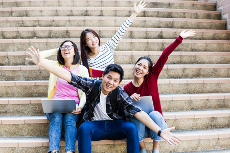 asian youth: group of happy teen high school students outdoors