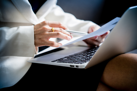 cpa: Business women reviewing data in financial charts and graphs