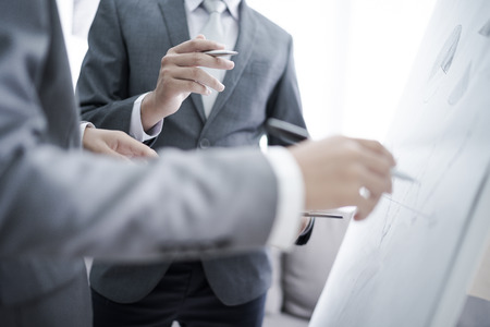 two young businessmen discussing project at meeting Stock Photo - 77021446