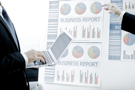 group  accountant: Business people discussing the charts and graphs showing the results of their successful teamwork Stock Photo